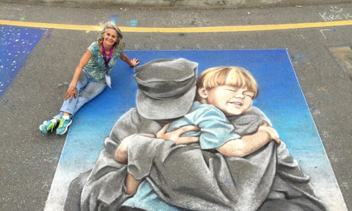 Artist Gayle DuRivage poses with one of her chalk murals. (Courtesy of Gayle DuRivage)