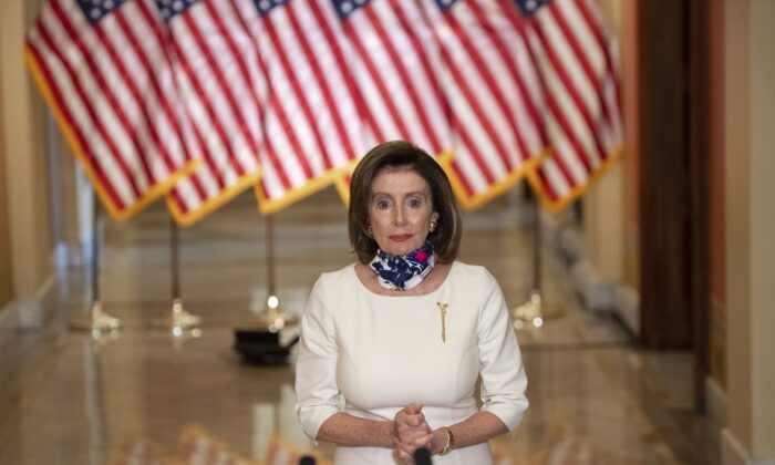 House Speaker Nancy Pelosi (D-Calif.) speaks about Democrats' newly unveiled $3 trillion package in Washington on May 12, 2020. (Saul Loeb/Pool via AP)