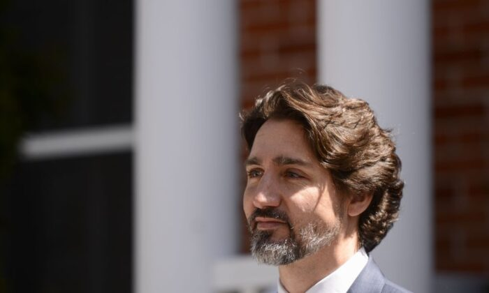 Prime Minister Justin Trudeau takes part in a press conference at Rideau Cottage during the COVID-19 pandemic in Ottawa on Wednesday, May 13, 2020. (Sean Kilpatrick / THE CANADIAN PRESS)