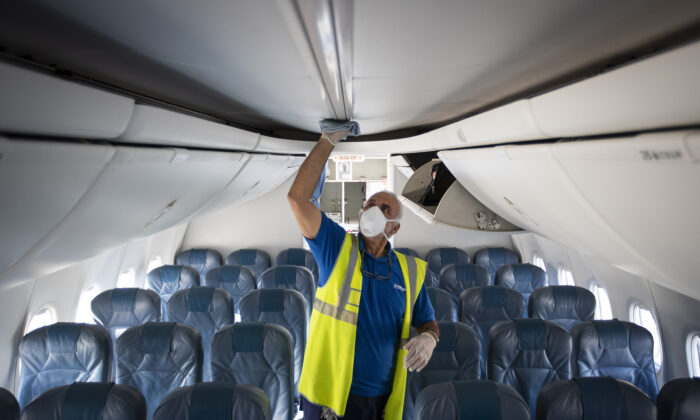 An employee wearing a face mask conducts a disinfectin inside an Air Europa's aircraft at Son Sant Joan's Airport in Palma de Mallorca on April 30, 2020, as the country prepares to ease its tough lockdown measures. (Jaime Reina/AFP via Getty Images)