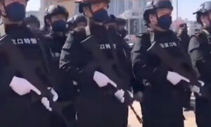 Armed Police Patrol Parts of Beijing As Pandemic Spreads