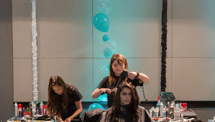 Beauticians practice their craft at the Professional Beauty Federation of California (PBRC) in Sacramento, Calif. The PBRC filed a lawsuit against Gov. Gavin Newsom on behalf of the state's licensed beauty professionals on May 12, 2020. (Photo courtesy of PBFC)