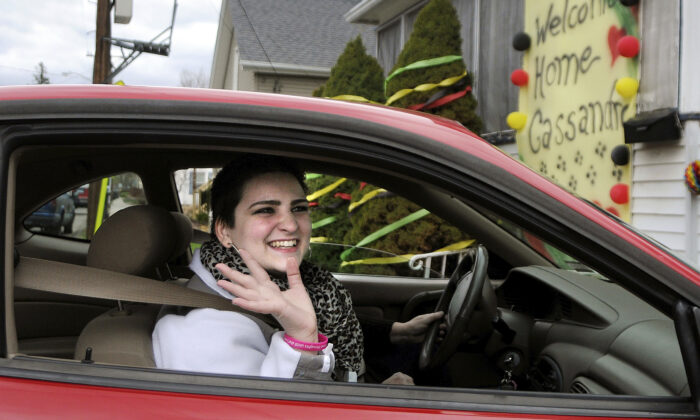 Cassandra Callender, arrives home with her mother, for the first time since December after a court-ordered chemotherapy for cancer treatment, in Windsor Locks, Conn., on April 27, 2015. (Stephen Dunn/Hartford Courant via AP)