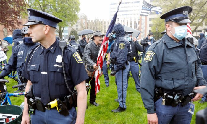 Michigan State Police patrol as demonstrators protest in Lansing, Michigan, on May 14, 2020. (Jeff Kowalsky/AFP via Getty Images)
