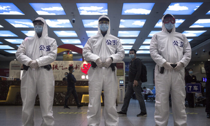 Police stand guard at a railway station in Wuhan, China, on April 7, 2020. (Getty Images)
