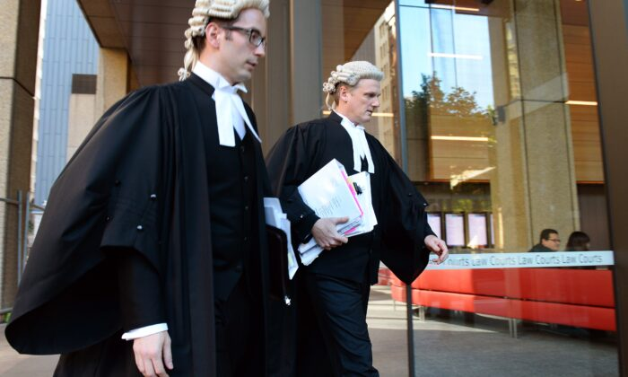 Barrister Christopher Withers (R) and an unidentified legal associate enter the Supreme Court of New South Wales in Sydney on October 9, 2013.       ( WILLIAM WEST/Getty Images)
