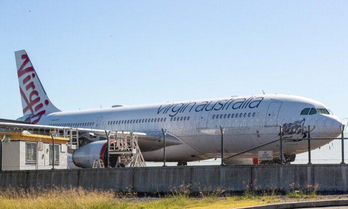 Grounded Virgin Plane, Brisbane Airport, Brisbane, Australia, April 21, 2020. (Jono Searle/Getty Images)