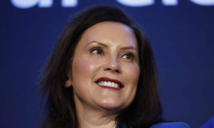 Michigan Gov. Gretchen Whitmer stands on stage at an event where General Motors announced that GMs Detroit-Hamtramck Assembly plant will build the all-electric Cruise Origin self-driving shuttle on Jan. 27, 2020 in Hamtramck, Mich. (Bill Pugliano/Getty Images)