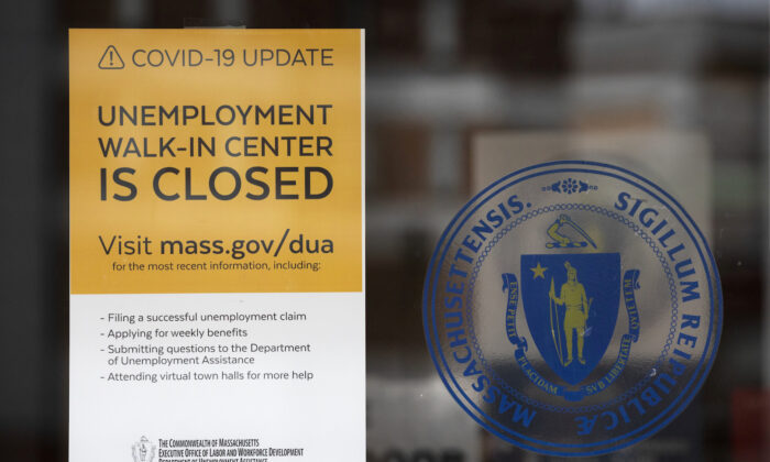 A sign announces the closure of the Massachusetts unemployment office, in Boston, on May 9, 2020. (Michael Dwyer/AP Photo)