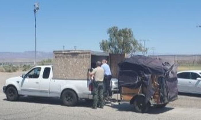 Police in California arrested three people on child endangerment charges this week after five children were found in the bed of a pickup truck in sweltering weather. (San Bernardino County Sheriff's Department)