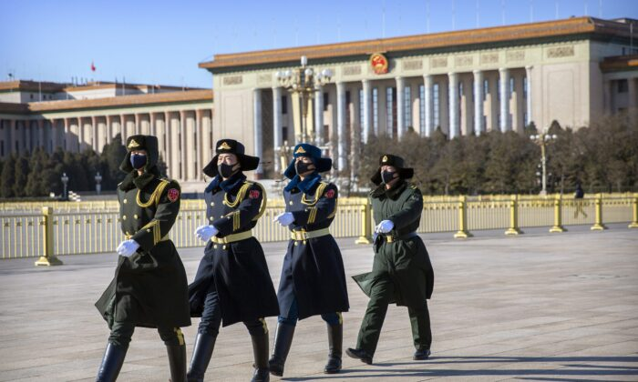 Members of a Chinese honour guard march in formation near the Great Hall of the People on Tiananmen Square in Beijing. (Mark Schiefelbein/AP Photo)