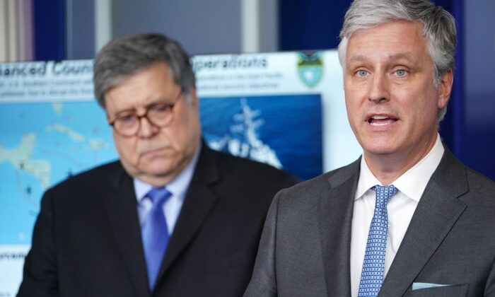 National Security Advisor Robert O'Brien (R) speaks, flanked by US Attorney General William Barr, during the daily briefing on the novel coronavirus, COVID-19, in the Brady Briefing Room at the White House on April 1, 2020, in Washington, DC. (Mandel Ngan/AFP via Getty Images)