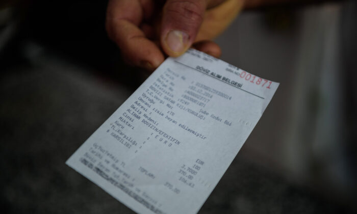 A stock photo of a receipt (Ozan Kose/AFP via Getty Images)