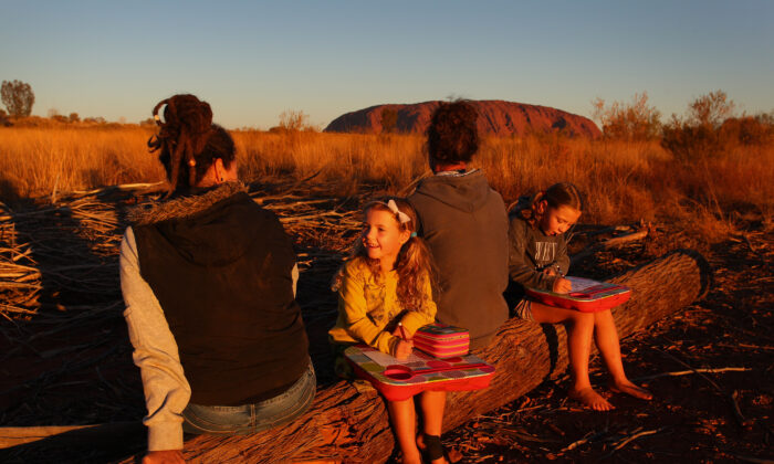 Michelle Pedrotti and Ryan Trott with their daughters take in the sunset view on August 13, 2019 in Uluru, Australia (Lisa Maree Williams/Getty Images)