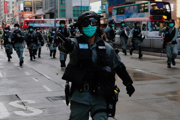 Riot police disperse anti-government protesters during a protest at Mong Kok in Hong Kong,