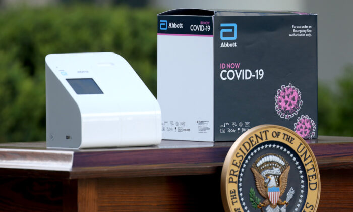 A new COVID-19 test kit developed by Abbott Labs in the Rose Garden of the White House in Washington on March 30, 2020. (Win McNamee/Getty Images)