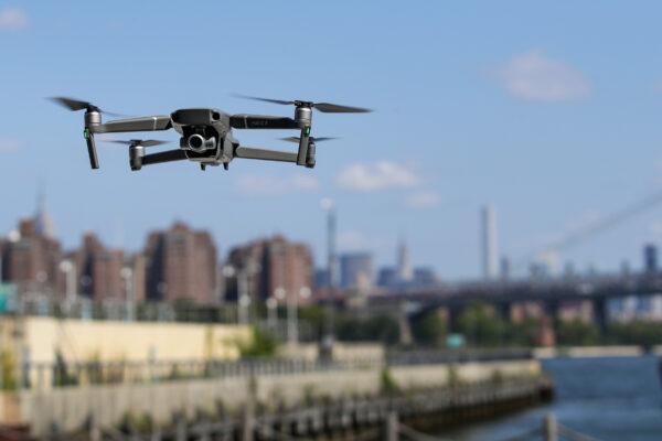 A DJI Mavic Zoom drone flies