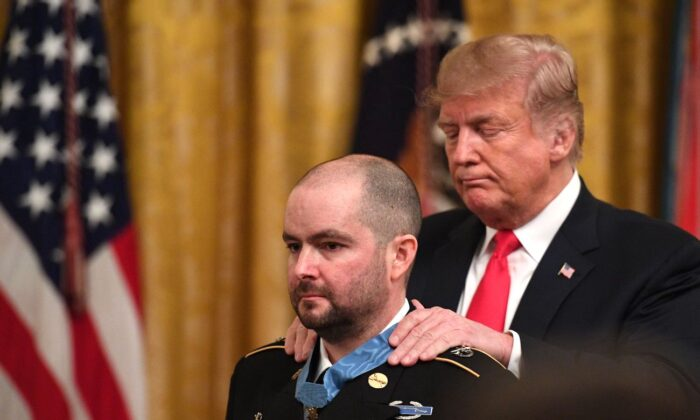 President Donald Trump awards the Medal of Honor to Ronald Shurer in Washington on Oct. 1, 2018. (Jim Watson/Getty Images)