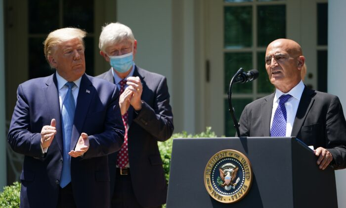 Chief Adviser of Operation Warp Speed Dr. Monecef Slaoui, right, with President Donald Trump, speaks on vaccine development in the Rose Garden of the White House in Washington on May 15, 2020. (Mandel Ngan/AFP via Getty Images)