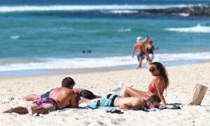 Queenslanders Frolic as Restrictions Ease