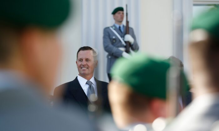 Acting Director of National Intelligence Richard Grenell stands in front of a military honor guard in Berlin, Germany, on May 8, 2018. (Odd Andersen/AFP/Getty Images)