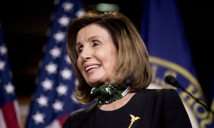 House Speaker Nancy Pelosi smiles during a news conference on Capitol Hill in Washington, on May 14, 2020. (AP Photo/Andrew Harnik)