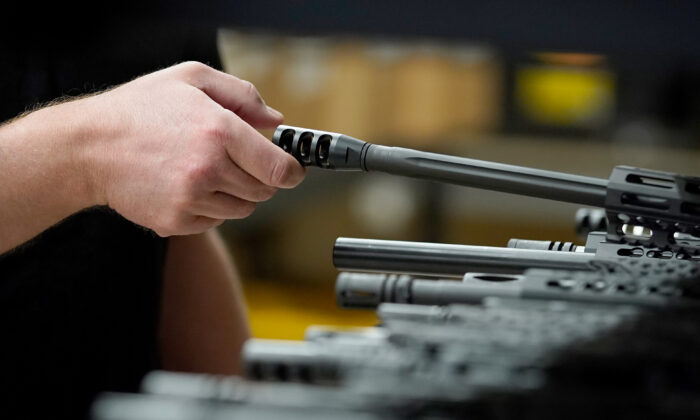 Finished AR-15 rifle barrels are stacked on shelves at Delta Team Tactical in Orem, Utah, on March 20, 2020. (George Frey/AFP via Getty Images)