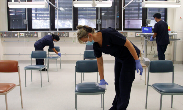 Nurse's wipe down the clinical assessment room, St George Hospital, Sydney, NSW Australia  May 15, 2020. (Lisa Maree Williams/Getty Images)