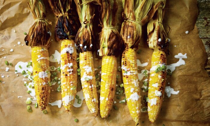 """""""Grilled corn is already good on its own,"""" writes Leela Punyaratabandhu, """"but what makes pot ang special is the coconut sauce that coats it""""—velvety, at once sweet and salty, and spiked with scallions. (Photo by David Loftus)"""