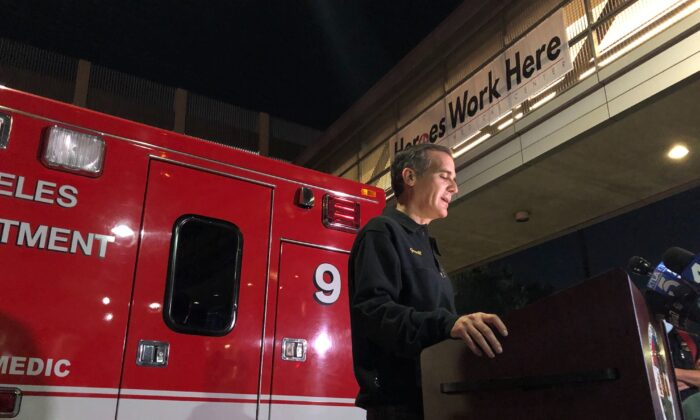 Los Angeles Mayor Eric Garcetti, stands next to Engine 9, updates the media on the conditions of multiple Los Angeles Fire Department firefighters who were injured in an explosion, in Los Angeles on May 16, 2020. (Stefanie Dazio/AP Photo)