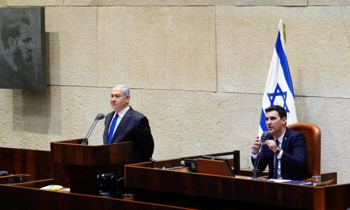 Israeli Prime Minister Benjamin Netanyahu speaks during a swearing in ceremony of his new unity government with election rival Benny Gantz, at the Knesset, Israel's parliament, in Jerusalem, on May 17, 2020. (Adina Valman/Knesset spokespersons' office/Handout via Reuters)