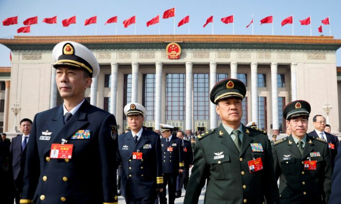 Military delegates leave the Great Hall of the People after a meeting ahead of National People's Congress (NPC), China's annual session of parliament, in Beijing, China, on March 4, 2019. (Aly Song/File Photo/Reuters)