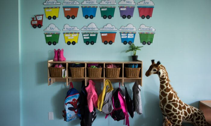 Children's backpacks and shoes are seen at a daycare, in Langley, B.C., on May 29, 2018. (Darryl Dyck/The Canadian Press)