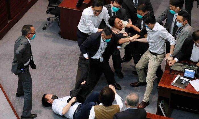 Pan-democratic legislators Chan Chi-chuen and Chu Hoi-dick scuffle with security during Legislative Council's House Committee meeting, in Hong Kong, China, on May 18, 2020. (Tyrone Siu/Reuters)