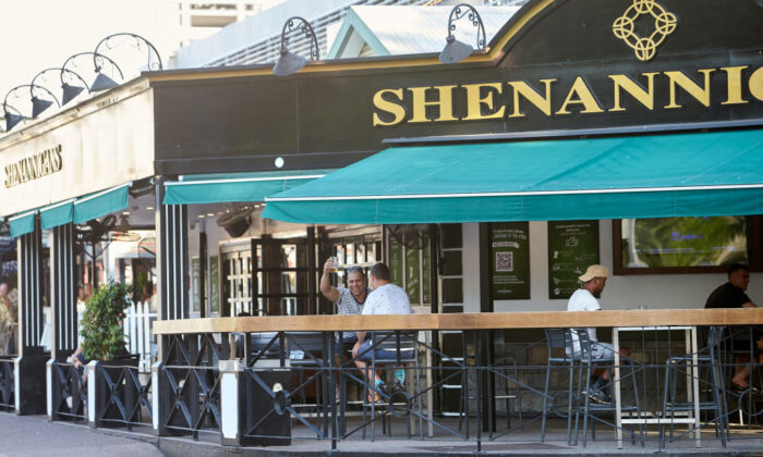 People sit and drink at Shenannigans Restaurant Bar on Mitchell St on May 15, 2020 in Darwin, Australia. Restrictions across the Northern Territory will ease further as COVID-19 cases continue to decline. (Shane Eecen/Getty Images)