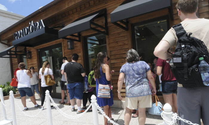 Guests attend the PANDORA Jewelry At Disney Springs Grand Opening in Buena Vista, Fla. on May 21, 2016. (Gerardo Mora/Getty Images for PANDORA)