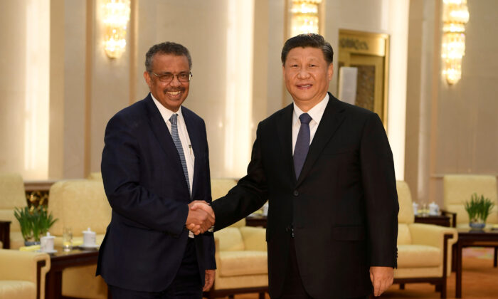 Tedros Adhanom, director general of the World Health Organization, shakes hands with Chinese leader Xi Jinping before a meeting at the Great Hall of the People in Beijing, China, Jan. 28, 2020. (Naohiko Hatta/Pool via Reuters)