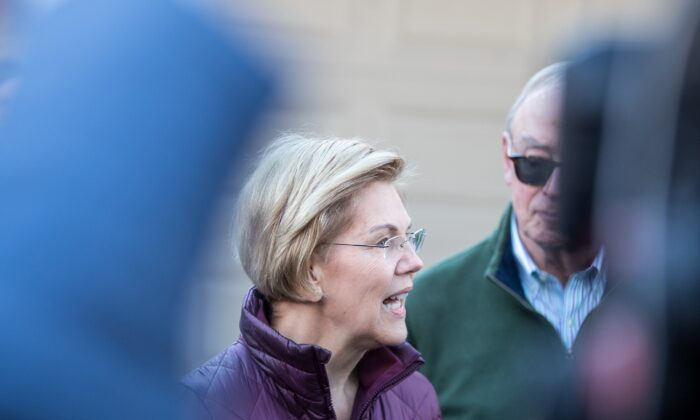 Sen. Elizabeth Warren (D-Mass.) outside her Cambridge, Mass., house on March 5, 2020. (Scott Eisen/Getty Images)