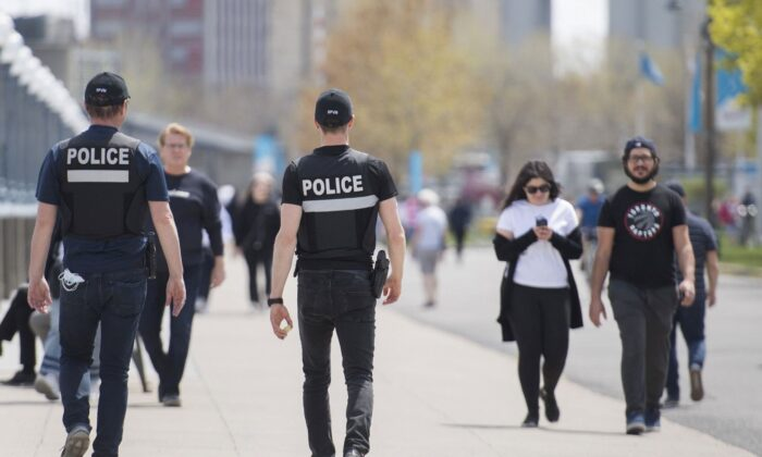Police patrol Montreal's Old Port on May 17, 2020, as the COVID-19 pandemic continues. (The Canadian Press/Graham Hughes)