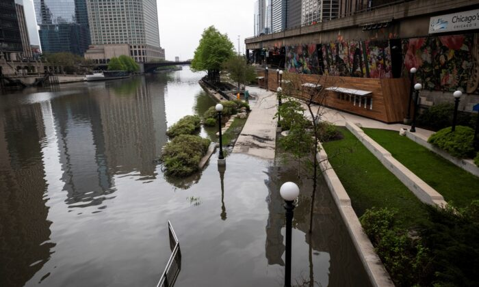The Chicago River overflowed its banks and flooded the Riverwalk after overnight showers and thunderstorms across the city, in Chicago, on May 18, 2020. (Ashlee Rezin Garcia/Chicago Sun-Times/AP)