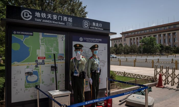 Paramilitary police officers guard near the Great Hall of the People (back) in Beijing on May 18, 2020. (NICOLAS ASFOURI/AFP via Getty Images)