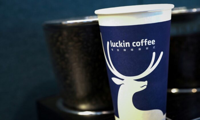 A cup of 'Luckin Coffee' coffee is displayed during the company's IPO at the Nasdaq Market site in New York on May 17, 2019. (Brendan McDermid/File/Reuters) Photo/File Photo