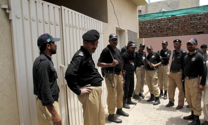 File photo of Pakistani policemen standing guard outside the house of another suspected honor killing victim, social media celebrit Qandeel Baloch who was murdered by her brother, in Multan on July 16, 2016. (Shahid Saeed Mirza/AFP/Getty Images)