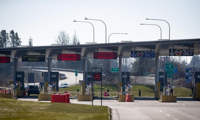 The U.S. port of entry into Blaine, Wash., is seen at a very quiet Douglas-Peace Arch border crossing, amid concerns about the spread of the coronavirus in Surrey, B.C., on Wednesday, March 18, 2020. The United States has agreed to Canada's request to extend the mutual ban on non-essential cross-border travel until June 21. (Darryl Dyck/The Canadian Press)