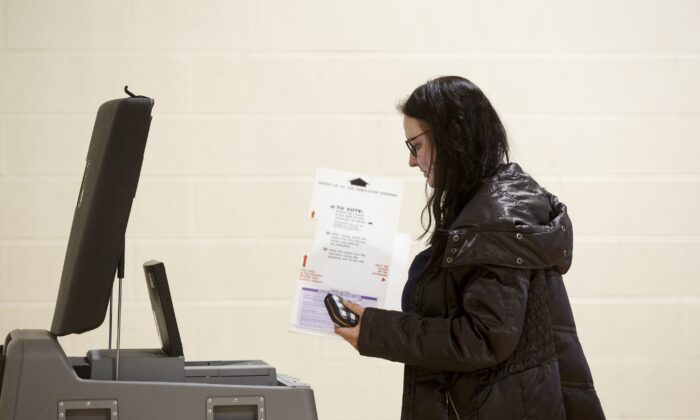 A woman holds a ballot at a polling place at Cromie Elementary School in Warren, Mich. on March 10, 2020. (Elaine Cromie/Getty Images)
