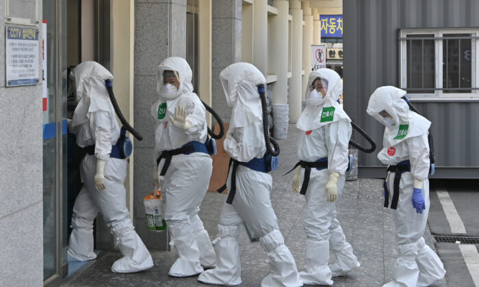 South Korean nurses wearing protective gear arrive for their shift to care for patients infected with the CCP virus at Keimyung University Daegu Dongsan Hospital in Daegu on April 29, 2020. (Jung Yeon-je/AFP/Getty Images)