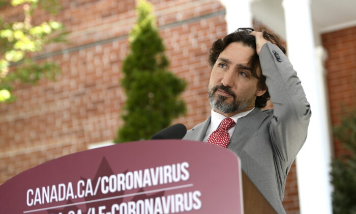 Prime Minister Justin Trudeau listens to a question during his daily news conference on the COVID-19 pandemic outside his residence at Rideau Cottage in Ottawa, on  May 20, 2020. (Justin Tang/THE CANADIAN PRESS)