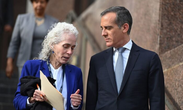 Los Angeles County Public Health director Barbara Ferrer (L) and Mayor Eric Garcetti (R) speak as they arrive for a press conference in Los Angeles on March 4, 2020. (Robyn Beck/AFP via Getty Images)