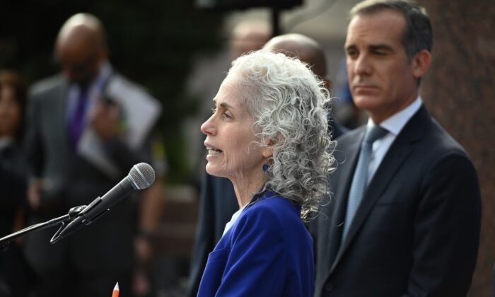 Los Angeles County Public Health director Barbara Ferrer speaks as Mayor Eric Garcetti (R) looks on at a press conference in Los Angeles, Calif., on March 4, 2020. (Robyn Beck/AFP via Getty Images)