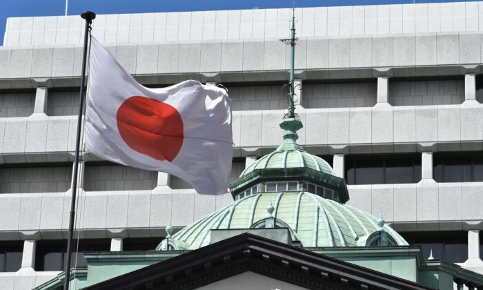 The Japanese national flag is seen at the Bank of Japan headquarters in Tokyo on March 16, 2020. (Kazuhiro Nogi/AFP via Getty Images)